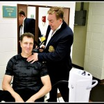 Dr James Stoxen DC using the MassageAssist with Simon Pryce
